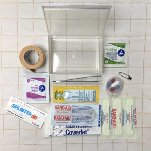 First-aid kit in small rectangular plastic container